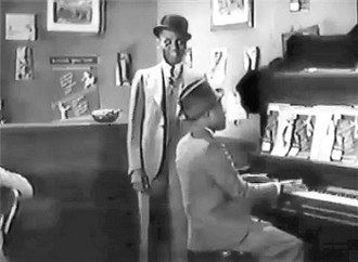 """Harlem Is Heaven - Bill Robinson singing """"Is You or Is You Ain't"""" with Putney Dandridge on piano"""
