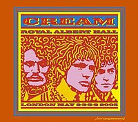 A psychedelic-style line drawing of the members of Cream (from left to right: Ginger Baker, Eric Clapton, and Jack Bruce), circa the late 1960s. The band members are pink with yellow and red highlights and the logo of the band and album name are red on a blue background. The autograph of artist John Van Hamersveld is in the lower right corner.