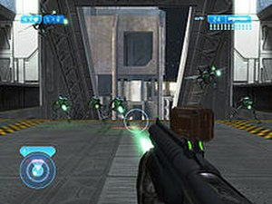 Halo 2 - In-game screenshot of Halo 2 for Xbox; the player character aims a shotgun at enemy Covenant.