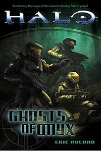 Cover shows three armor-clad figures carrying futuristic guns.