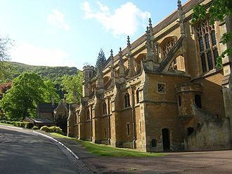 Malvern College - The College chapel with the Porter's Lodge and the Malvern Hills in the background