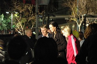 Murray Rose - Murray Rose being interviewed by a Seven News journalist during a live cross of the evening news bulletin to Circular Quay in Sydney prior to the opening ceremony of the 2008 Beijing Olympics.