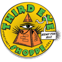 """Yellow circular logo with """"Third Eye Shoppe"""", """"Portland"""", """"OR"""" , and """"Hemp for All!"""" displayed at the edges; in the center is the Eye of Providence within a pyramid"""