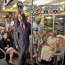 A man is standing in the middle of a subway car, wearing a suit. He is surrounded by seemingly normal people (e.g. commuters); however, the man has a poodle sitting atop his head.