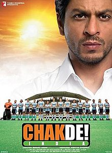 Theatrical release poster depicts coach Kabir Khan, looking over the bad Indian Women's National Field Hockey Team. Text at the bottom of the poster provides the title, tagline, production credits and release date.