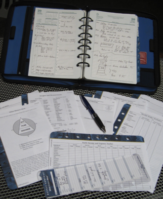 Franklin Planner - Franklin Planner in binder with various examples of data forms.