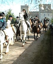 A mixed field of horses at a hunt, including children on ponies