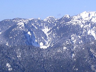 North Shore Mountains - A view of the North Shore Mountains as seen looking west from the Mount Seymour alpine area in March. The obvious sharp-pointed peak near the upper right is Crown Mountain