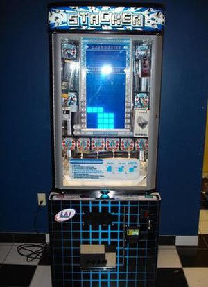 Stacker (game) - Picture of the standard size game machine; there is also a larger version which can hold larger prizes.