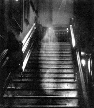Brown Lady of Raynham Hall - Brown Lady of Raynham Hall claimed photograph of the ghost, Captain Hubert C. Provand. First published in Country Life, 1936