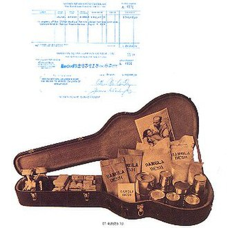 The Concert for Bangladesh (album) - The album booklet's back cover, showing a cheque for the concerts' box-office takings above a guitar case packed with emergency supplies; copyright Apple Records