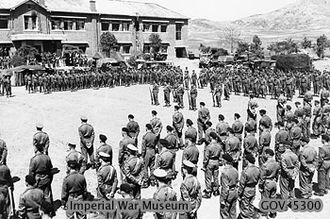 Non-U.S. recipients of U.S. gallantry awards - Representatives of United Kingdom, Canadian, Australian and Belgian units of the British 29th Brigade stand at Parade Rest, during ceremonies in which the American Presidential Unit Citation was awarded to the Gloucestershire Regiment and the 170th Independent Mortar Battalion, Royal Artillery, 8 May 1951.
