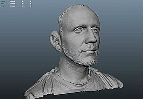 A digital rendering of a man's face in a motion capture software.