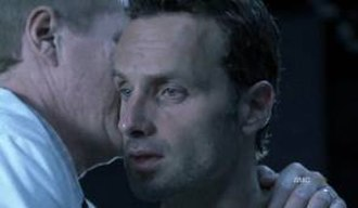 TS-19 - Dr. Edwin Jenner whispers something to Rick.