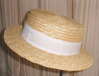 Boater straw hat with a straight brim, flat crown and ribbon hatband