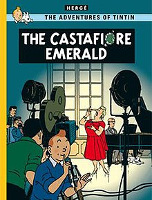 Tintin is looking at us, signalling us to stay quiet, as Castafiore is being filmed for television in the background while at Marlinspike Hall.