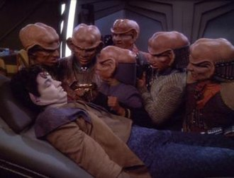 The Magnificent Ferengi - The Ferengi look over a dead Keevan