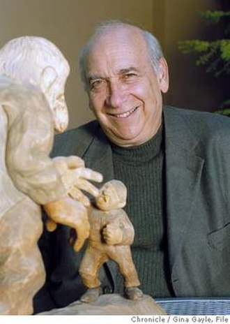 "Alan Dundes - Alan Dundes with a wooden Norwegian statue of a tale called ""Squeezing the Stone"""
