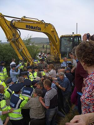Shell to Sea - Members of the Garda Síochána and Shell to Sea campaigners scuffle over ownership of a road in June 2007. Gardaí eventually conceded the road was private property.