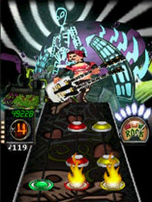 Guitar Hero Mobile series - Screenshot of the three column Fretboard. Above Judy Nails plays a double neck guitar.