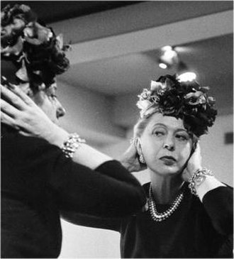 Lilly Daché - Scrutinising her new hat design in 1956
