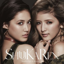 "A close-up of two Japanese women (left to right: Karen Fujii and Shuuka Fujii) wearing jewellery and clothes. The title ""ShuuKaRen"" and the two women's name are superimposed on this shot."
