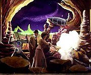 "A scene from the ""Tonight, Tonight"" music video, winner of the MTV Video Music Award for Video of the Year in 1996. Drawing heavy influence from Georges Méliès's A Trip to the Moon, the video was filmed in the style of a turn-of-the-century silent film using theater-style backdrops and primitive special effects."