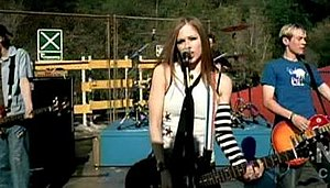 Complicated (Avril Lavigne song) - After the video, Lavigne influenced girls around the world with her style – wearing tie, Chuck Taylor All-Stars and skater clothes.