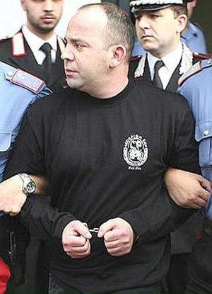 Francesco Vottari - Italian police force escort Francesco Vottari following his arrest in San Luca