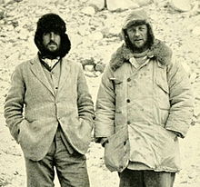 Monochrome photo of two men looking like hikers on a cold day