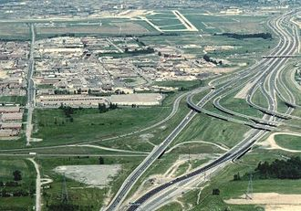 Ontario Highway 403 - Highway 401 junction with Highways 403 and 410 in 1987. Note the unused right-of-way in the middle of the interchange reserved for the future Highway 401 express lanes and flyover ramps to Highway 410.
