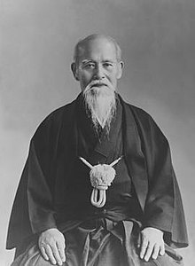 Portrait of an elderly Japanese man in traditional kimono