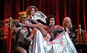 "The Rocky Horror Picture Show - Little Nell, Patricia Quinn, Tim Curry, and Richard O'Brien in ""The Rocky Horror Picture Show"". All were in the original stage show. Production design by Brian Thomson, costumes by Sue Blane, and musical arrangement by Richard Hartley, all reunited alumni of the London stage production."