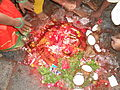 Brightly colored shrine with offerings left behind