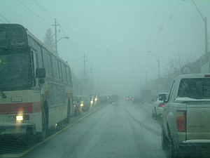 Snowsquall - A hybrid Frontal-Lake Effect Snowsquall hitting Toronto, Canada during rush hour.