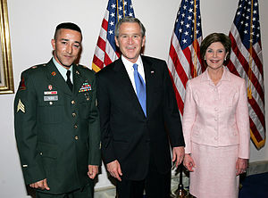 Pakistani Americans - Then President George W. Bush and Laura Bush with Pakistani American U.S. Army Sgt. Wasim Khan at the 2004 State of the Union Address, U.S. Capitol building, February 1, 2004.
