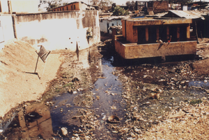Slum networking - World Bank funded public toilet block in Indore City, surrounded by a cesspit