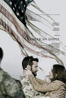 Chris Kyle is seen wearing desert fatigues army BDU, while his wife Taya embraces him. They are standing in front of a tattered US flag.