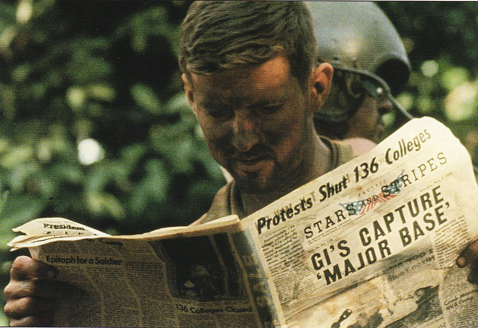American soldier during the Cambodian Campaign, reading the Stars and Stripes