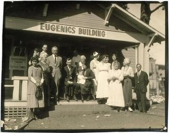 Eugenics in the United States - Winning family of a Fitter Family contest stand outside of the Eugenics Building (where contestants register) at the Kansas Free Fair, in Topeka, KS.