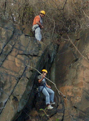 East Rock Park - Friends of East Rock, New Haven Graffiti Clean up. The experienced rock climbers of the group rappelled off the rock to get the harder to reach places