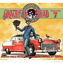 A skeleton, wearing a tuxedo suit and an Uncle Sam top hat, holds a bouquet of roses while leaning against a red and white '55 Chevy. A cardinal perches on the hood of the car, and a turtle walks nearby.