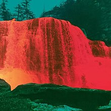 A color-inverted photograph of a waterfall