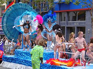 A festive float with costumed dancers at San F...