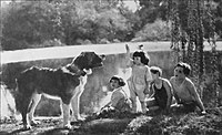 A group of children with Buck in a scene from the movie