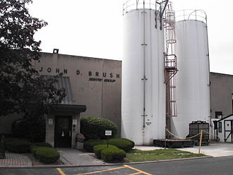Sentry Group - The factory side entrance of the Linden Avenue plant in Rochester, NY. At the base of the silos are a furnace (used to fire-test safes) and a rock pit (used for drop-testing safes from a height 30. ft.)