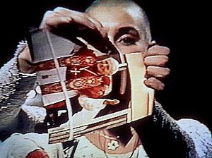 Sinéad O'Connor - O'Connor ripping a picture of the Pope