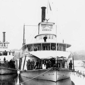 The large trapezoidal tarpulin rigged over the foredeck was a distinctive feature of Willamette River sternwheelers.