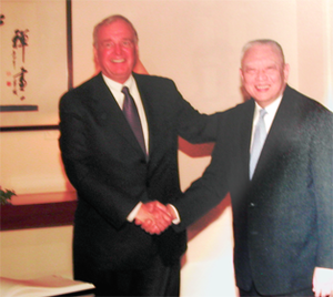 Tung Chee-hwa - Tung Chee Hwa shaking hands with Paul Martin, the Prime Minister of Canada at the Government House on 22 January 2005.