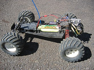 Radio-controlled car - A Traxxas Electric Rustler - A Rear Wheel Drive Stadium Truck (without body).